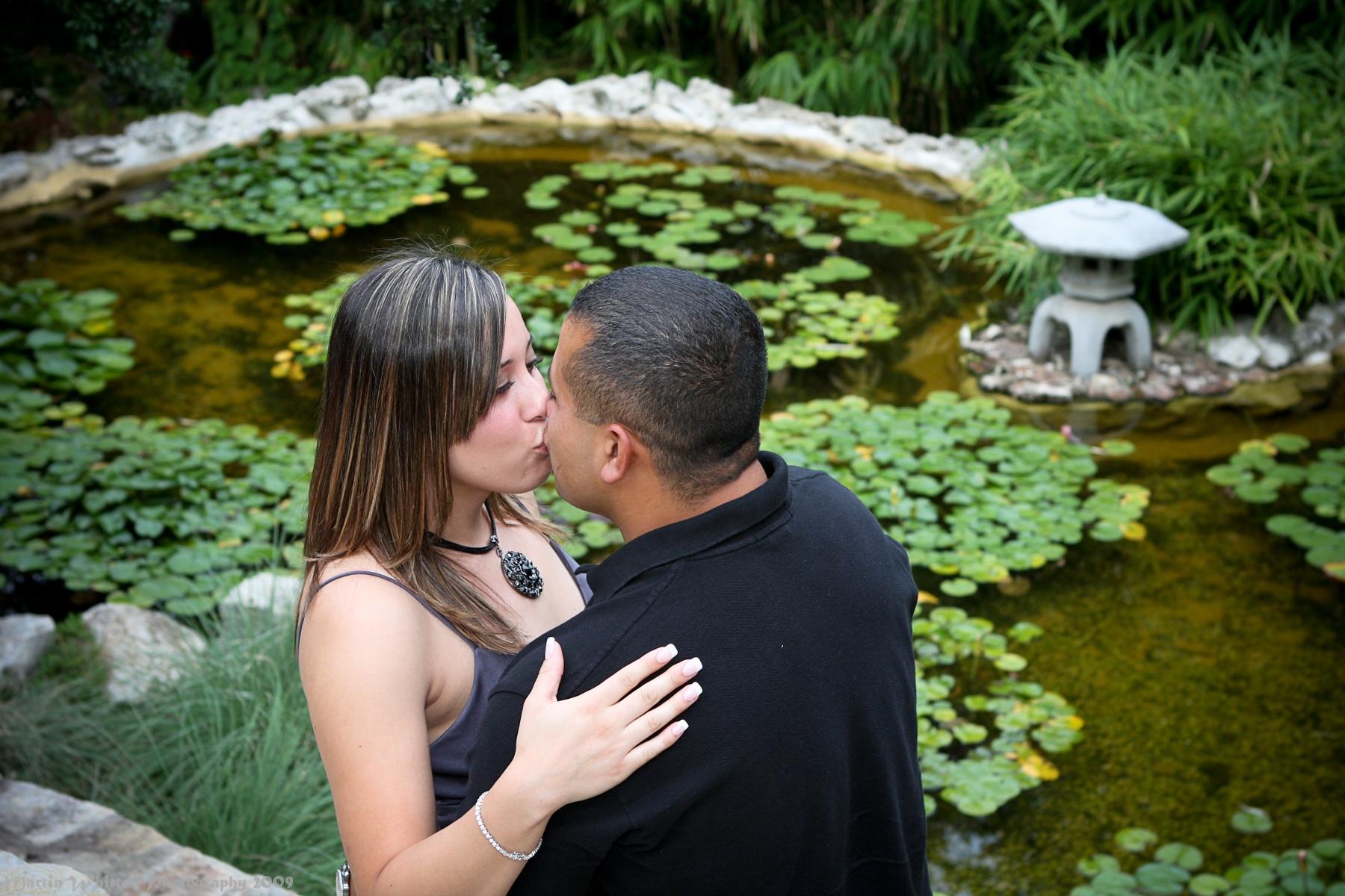 A Kiss Is Captured Next To A Koi Pond At Zilker Botanical Garden U2026