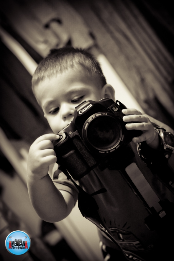 Son learning photography